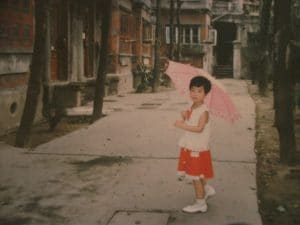 small-chinese-girl-holding-umbrella