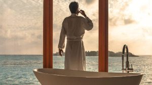 man-standing-besides-bathtub-caribbean-scenery