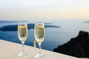 glasses-of-champagne-besides-sea
