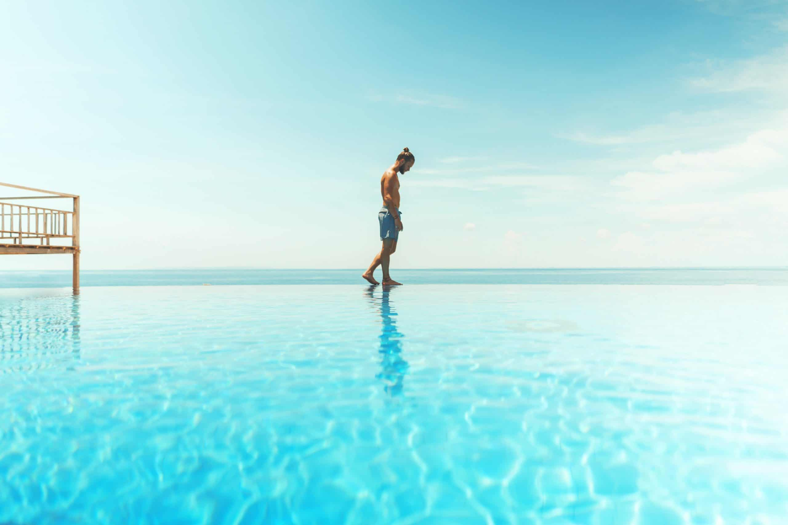 blonde-man-walking-on-blue-water-in-the-caribbean