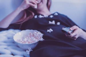 woman-on-couch-eating-popcorn