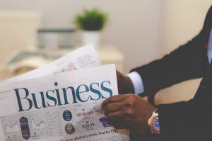 man-reading-business-journal