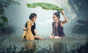 two-chinese-girls-in-rain