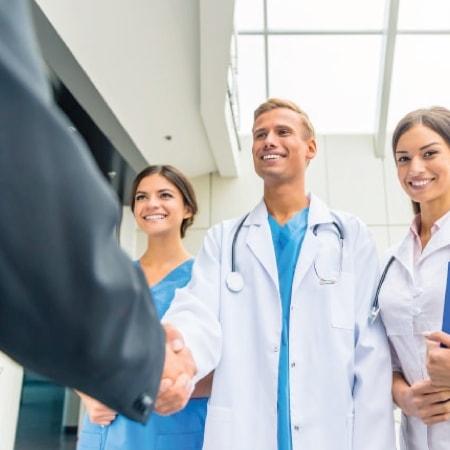medical interpreters shaking hands